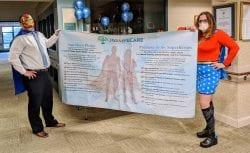 JGS Lifecare employees hold the Superhero Pledge Banner
