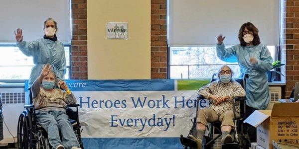 Hero banner with two residents and two staff members of JGS Lifecare