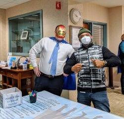 JGS Lifecare employees sign the Superhero Pledge