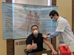 Rob Whitten, Leavitt Family Nursing Home Executive Director, receives his COVID-19 Vaccine