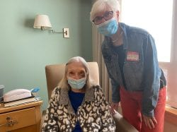 Ann Oliminsky enjoys a visit from long-time friend Mary Jo Salvon in her room at Sosin Center for Rehabilitation.