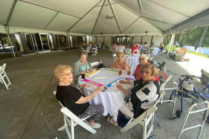 A table of four women playing mahjong at the Frankel Kinsler Golf Tournament
