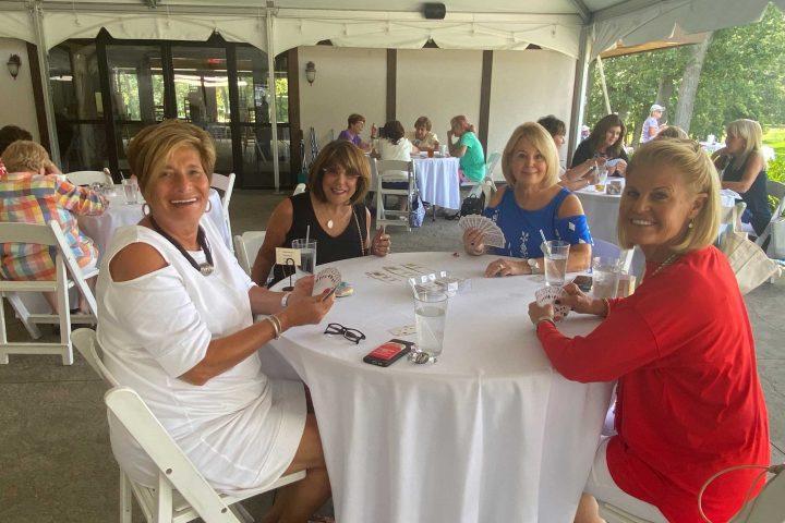 Women playing cards at the Frankel Kinsler Golf Tournament