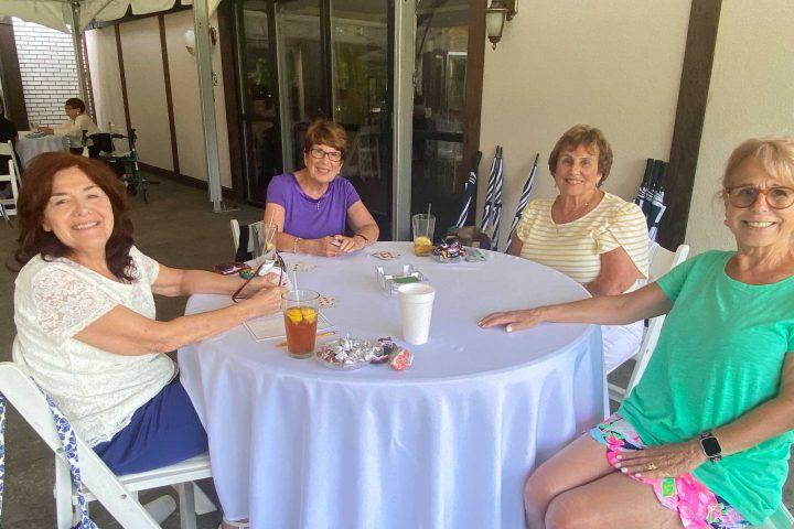 Women chatting at the Frankel Kinsler Golf Tournament
