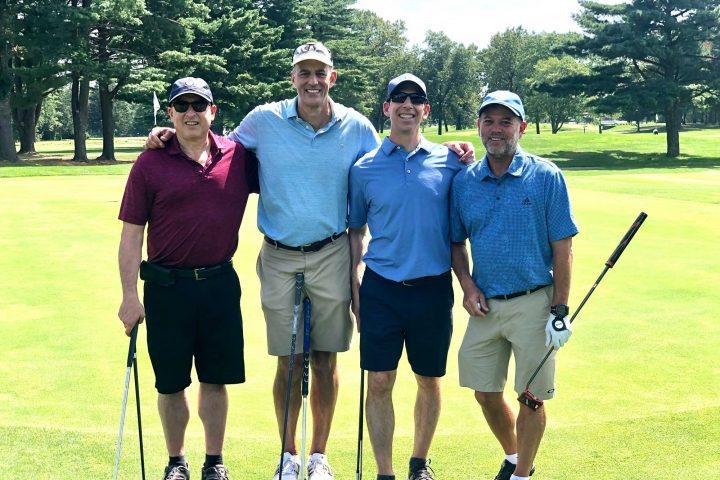 Four man team at the Frankel Kinsler Golf Tournament