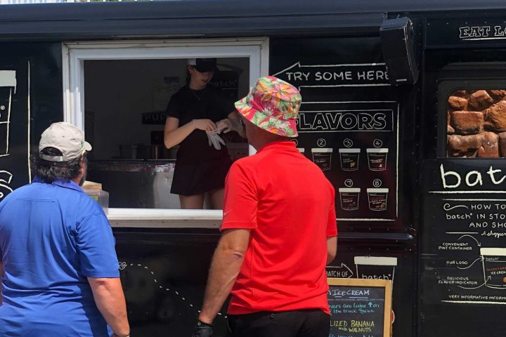 Two men ordering food at a food truck