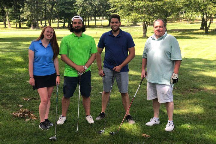 Four person team at the Frankel Kinsler Golf Tournament