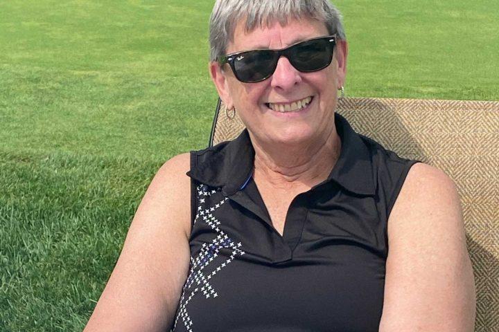 Terry Halliday sitting at the Frankel Kinsler Golf Tournament