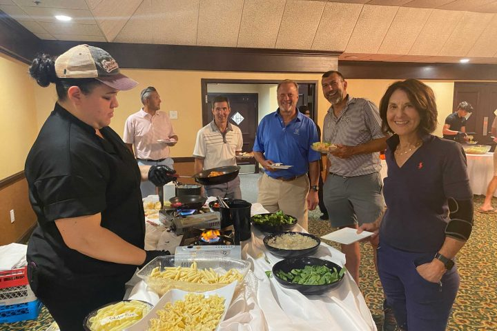 Guests enjoying a meal at the Frankel Kinsler Golf Tournament