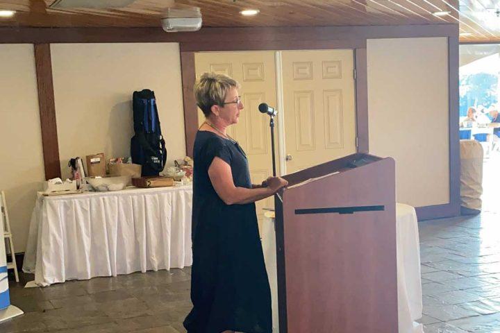 A speaker speaking at the Frankel Kinsler Golf Tournament