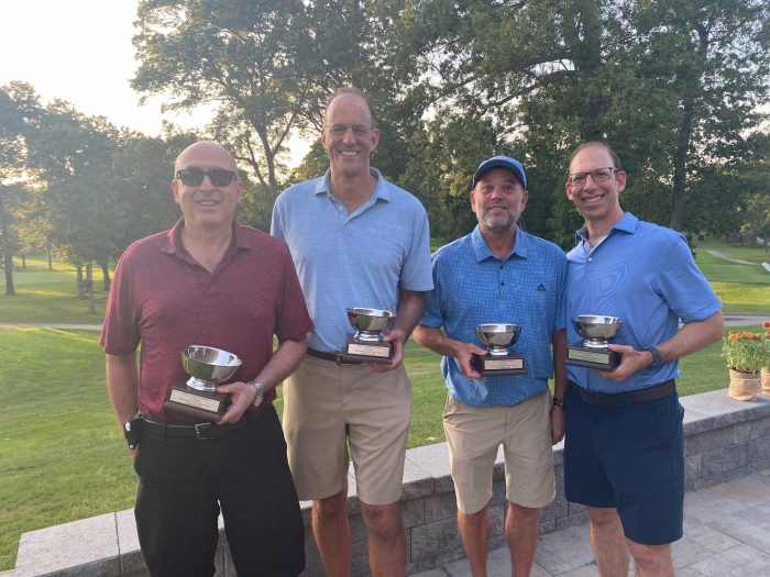 Winners posing with trophies at the Frankel Kinsler Golf Tournament