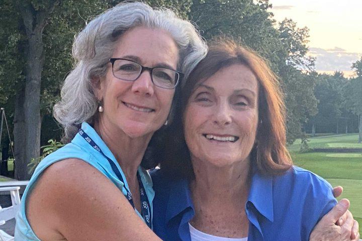 Susan Halpern posing with her mom at the Frankel Kinsler Golf Tournament