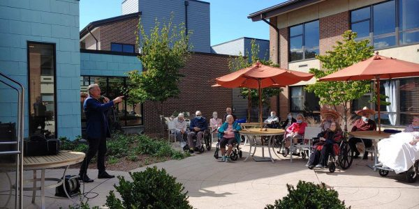 Jimmy Mazz performing for residents of JGS Lifecare