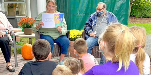Kids listening to a resident read the story written by Christina.